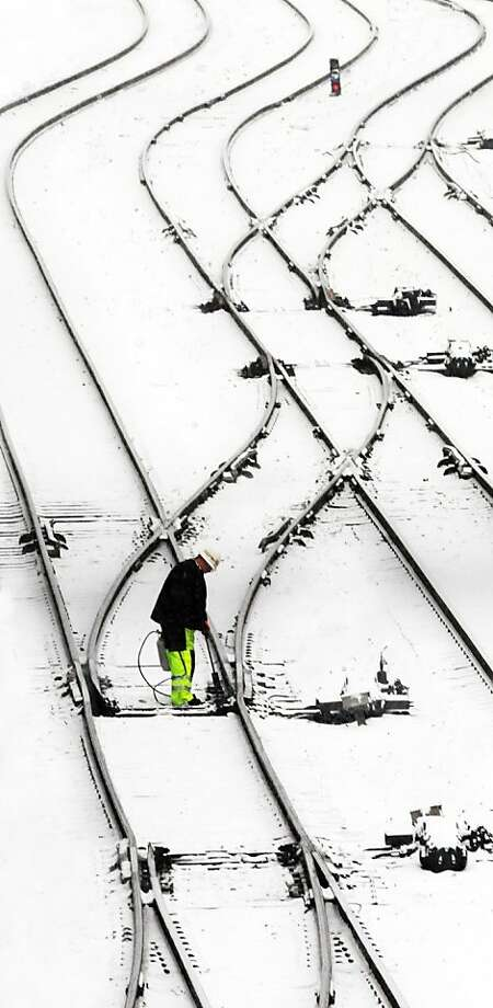 I came, I thawed: Signalman Phil Smith uses a propane torch to melt ice jamming track switches at the Norfolk Southern Roanoke Terminal. Photo: Don Petersen, Associated Press