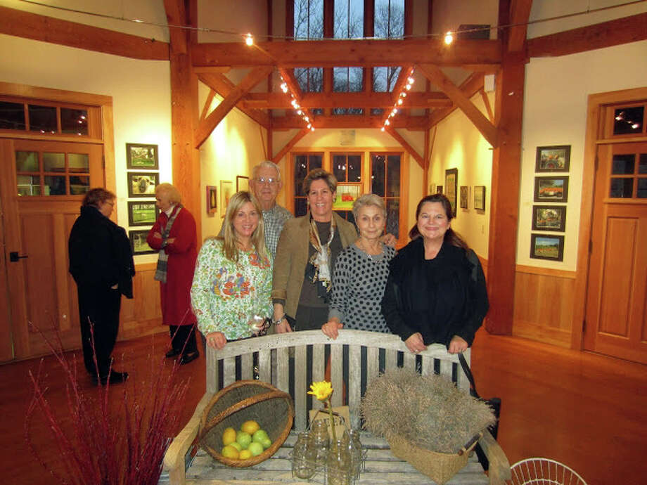 "Participants in the Darien Nature Center's ""Farmers Market"" exhibit gather at the opening reception. From left, artist Diane Weeks, former First Selectman Bob Harrel, nature center Executive Director Lynn Hamlen, artist Jan Raymond and photographer Karen Hughan. Local farmers will begin selling their produce at the nature center starting Wednesday, Jan. 30. Photo: Contributed"