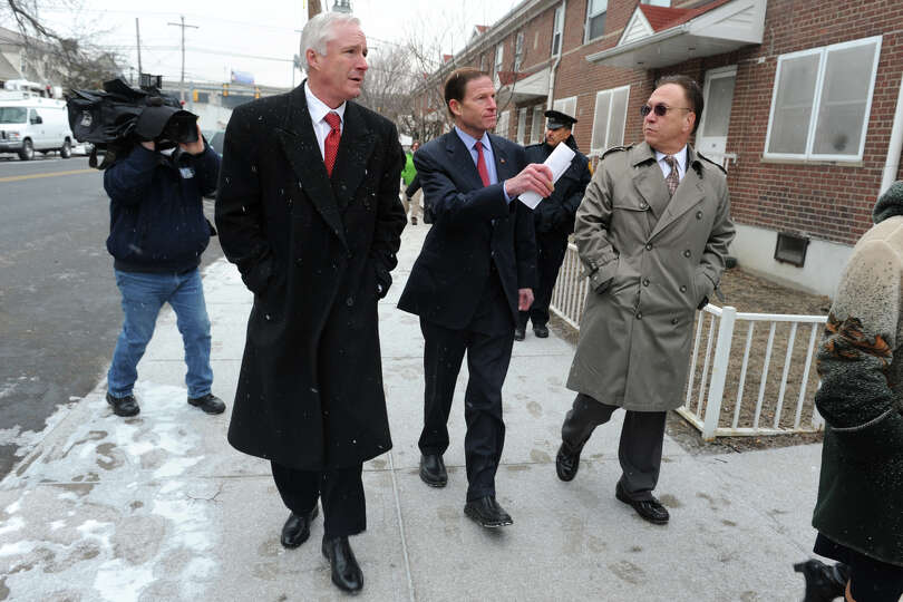 Senator Richard Blumenthal, center, walks with Mayor Bill Finch and Nicholas Calace from the Bridgep