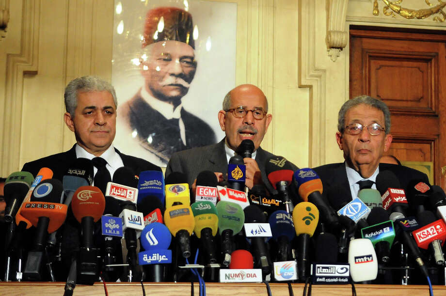 "Egyptian opposition leader and Nobel Prize laureate Mohamed ElBaradei (C), former presidential candidate Egyptian Member of Parliament Hamdeen Sabbahy (L) and former Arab League secretary general Amr Mussa attend a press conference in Cairo on January 28, 2013. Egypt's main opposition bloc has called for demonstrations nationwide on February 1, to achieve the ""goals of the revolution"", after turning down an invitation by President Mohamed Morsi for talks. AFP PHOTO / STR Photo: -, AFP/Getty Images / 2013 AFP"