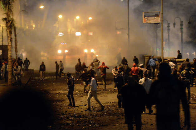 Egyptian protesters clash with riot police near Cairo?s Tahrir Square on January 28, 2013. Egypt's main opposition bloc rejected an invitation by President Mohamed Morsi for talks on the violence and political turmoil sweeping the country and instead called for fresh mass demonstrations. AFP PHOTO / KHALED DESOUKI Photo: KHALED DESOUKI, AFP/Getty Images / 2013 AFP