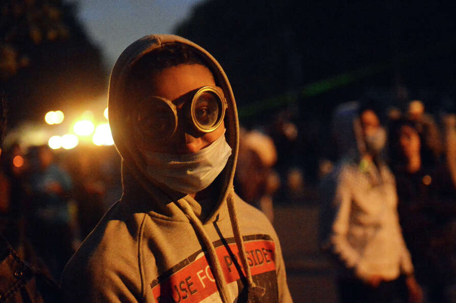 An Egyptian protester wearing glasses for protection attends a demonstration near Cairo's Tahrir Squ
