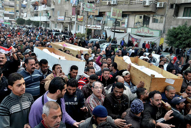 Egyptians attend the funeral of several Sunday victims of ongoing violence in Port Said, Egypt, Monday, Jan. 28, 2013. The worst violence in Egypt this past weekend was in the Mediterranean coastal city of Port Said, where at least 44 people died in two days of clashes. The unrest was sparked on Saturday by a court conviction and death sentence for 21 defendants involved in a mass soccer riot in the city's main stadium on Feb. 1, 2012 that left 74 dead. (AP Photo) Photo: STR, ASSOCIATED PRESS / AP2013