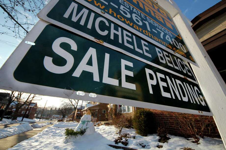 This Jan. 5, 2013, photo, shows a home with sale pending in Mount Lebanon, Pa. A measure of Americans who signed contracts to buy homes fell in December after reaching a 2 ½-year high in November. Photo: Gene J. Puskar, Associated Press / Associated Press