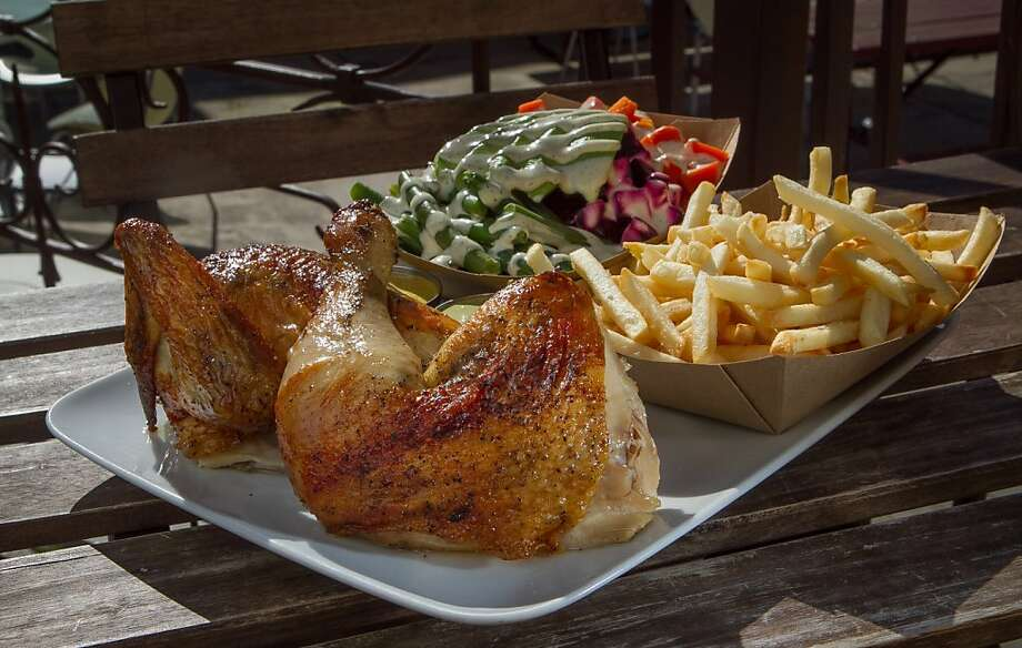 At Brasa, the roast chicken, above, is the star. Hot, succulent and crispy, it's served here as half a bird with a side salad and fries ($14.75). At right is the tofu sandwich ($8.50) with sweet potato fries (small portion $3, large $5). Far right, Brasa's space on University Avenue used to house the restaurant eVe. Photo: John Storey
