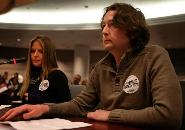 Siblings Tara and Eric Donnelly, whose parents were killed eight years ago during a robbery of their Fairfield   jewelry store, testify at the Gun Violence Prevention Working Group hearing at the Legislative Office Building in Hartford on Monday, January 28, 2013. Photo: Brian A. Pounds / Connecticut Post