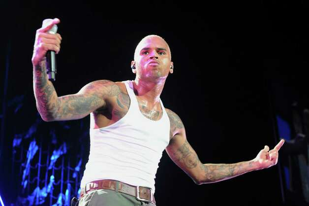 FILE - This Oct. 20, 2011 file photo shows Chris Brown performs live as part of the F.A.M.E Tour at The Staples Center in Los Angeles. Brown is under investigation for an alleged assault in a West Hollywood parking lot, the Los Angeles County Sheriff's Department said early Monday, Jan. 28, 2013.   Deputies responding to a report of six men fighting Sunday night found the scene clear, but were told by witnesses that there had been a brief fight over a parking space. (AP Photo/Katy Winn, file) Photo: Katy Winn