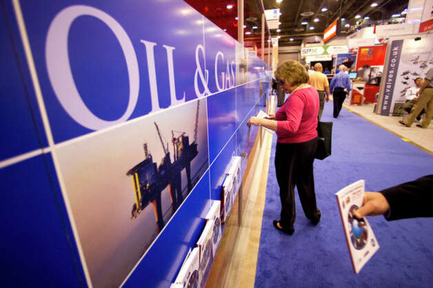 Visitors to the 2012 Offshore Technology Conference walk through the United Kingdom area of the conference Wednesday, May 2, 2012, in Houston. Photo: Brett Coomer, Houston Chronicle / © 2012 Houston Chronicle