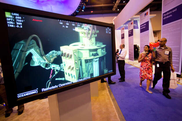 Video from a remotely operated vehicle is shown on a monitor at the Oceaneering booth during the 2012 Offshore Technology Conference Wednesday, May 2, 2012, in Houston. Photo: Brett Coomer, Houston Chronicle / © 2012 Houston Chronicle