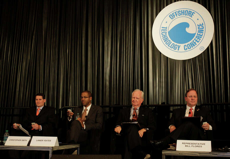 Robert Kessler, left , with Tudor, Pickering, Holt & Co.,  Christopher Smith, Deputy Assistant Energy Secretary, Lanier Yeates, with Gordon, Arata, McCollam, Duplantis & Eagan, and Congressman Bill Flores,  right, participate in an electronic survey during their panel discussion titled  consequences of Gulf spill at OTC at Reliant Center Wednesday, May 2, 2012, in Houston. Photo: Melissa Phillip, Houston Chronicle / © 2012 Houston Chronicle