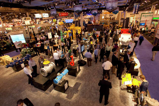 Attendees walk around the Cameron booth during the 2012 Offshore Technology Conference Wednesday, May 2, 2012, in Houston. Photo: Brett Coomer, Houston Chronicle / © 2012 Houston Chronicle