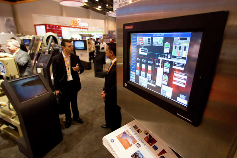 The display monitor of a solar powered monitoring unit is shown at the GE booth during the 2012 Offshore Technology Conference Wednesday, May 2, 2012, in Houston. Photo: Brett Coomer, Houston Chronicle / © 2012 Houston Chronicle