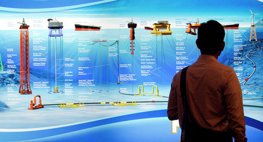 Various offshore oil equipment is displayed on a board at the Oil States Industries booth during the 2012 Offshore Technology Conference Wednesday, May 2, 2012, in Houston. Photo: Brett Coomer, Houston Chronicle / © 2012 Houston Chronicle