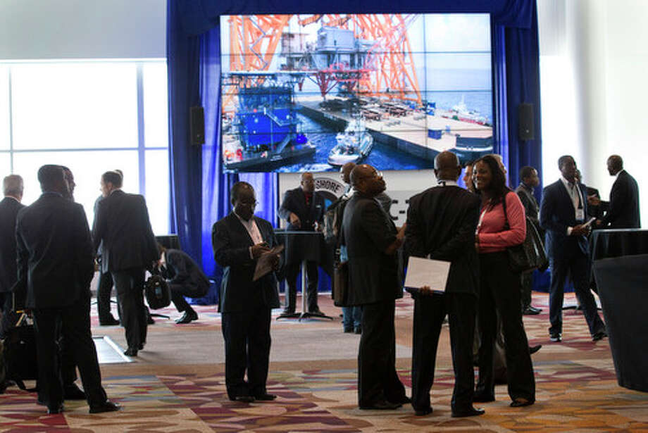 Attendees mingle in the main hallway at Reliant Center during the 2012 Offshore Technology Conference Wednesday, May 2, 2012, in Houston. Photo: Brett Coomer, Houston Chronicle / © 2012 Houston Chronicle