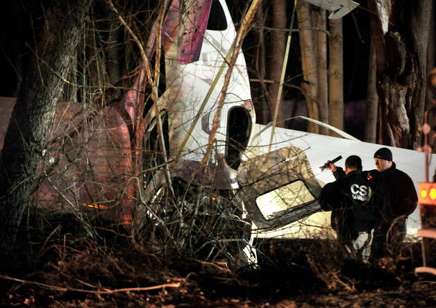 Investigators inspect the damage after an airplane crashed near the corner of South Street and Wixted Avenue in Danbury on Tuesday, Jan. 22, 2013. Photo: Jason Rearick / The News-Times