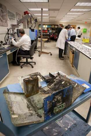 The case of a battery that caught fire aboard a Japan Airlines Boeing 787 plane at the National Transportation Safety Board offices in Washington, Jan. 24, 2013. The NTSB indicated Thursday that investigations into the failure of lithium-ion batteries aboard the Japan Airlines Boeing 787 and other 787 are still far from determining a cause. Photo: DANIEL ROSENBAUM, New York Times / NYTNS