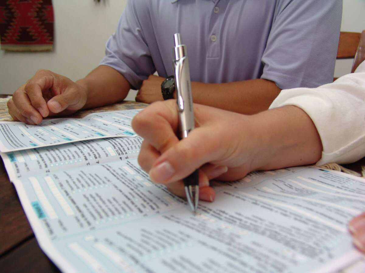 Filling out paper Census forms.