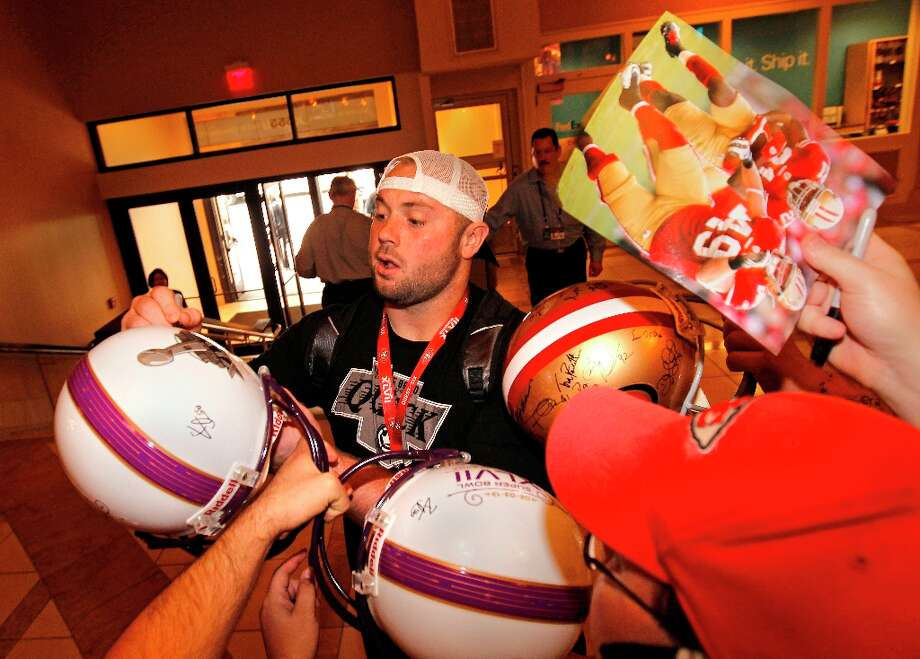Daniel Kilgore signs autographs as San Francisco fans line the team hotel entrance to get a glimpse of their favorite players, at the New Orleans Marriott hotel in New Orleans, Louisiana  on Monday Jan. 28,  2013. Photo: Michael Macor, The Chronicle / ONLINE_YES