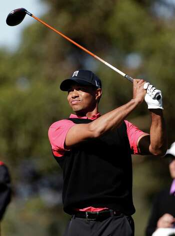 Tiger Woods watches his tee shot on the 10th hole during the fourth round of the Farmers Insurance Open golf tournament at the Torrey Pines Golf Course, Monday, Jan. 28, 2013, in San Diego. (AP Photo/Gregory Bull) Photo: Gregory Bull, Associated Press / AP