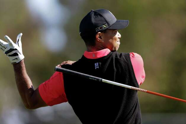 Tiger Woods lets his club fly as he watches his tee shot on the ninth hole go out of bounds to the right of the fairway during the fourth round of the Farmers Insurance Open golf tournament at the Torrey Pines Golf Course, Monday, Jan. 28, 2013, in San Diego. (AP Photo/Gregory Bull) Photo: Gregory Bull, Associated Press / AP