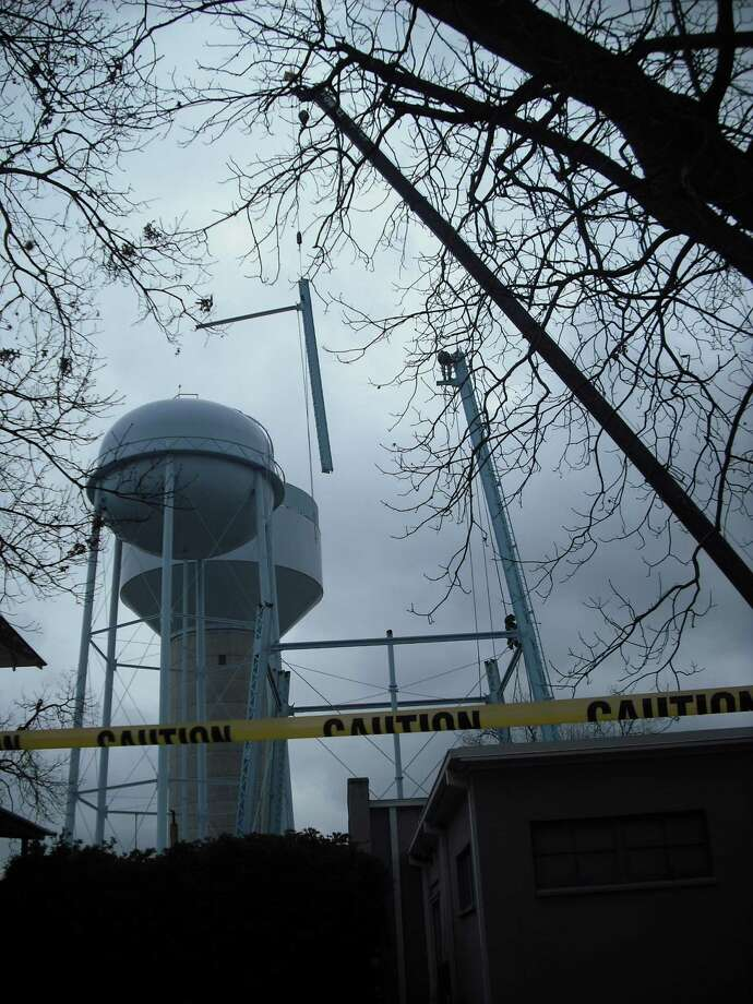 "Contractors spent Monday, Jan. 28, 2013, taking down, piece by piece, Alamo Heights' water tower -- nicknamed by residents ""The Tin Man."" The structure dates back to 1928. Photo: Edmond Ortiz, North Central News"