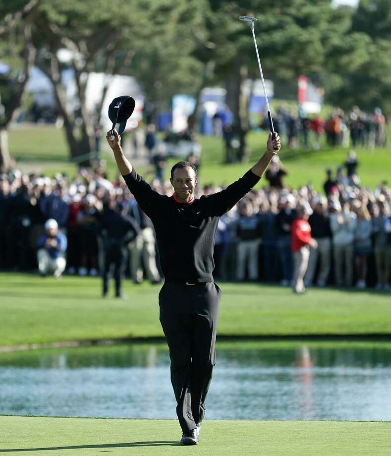 Tiger Woods celebrates after his victory in the Farmers Insurance Open. Photo: Gregory Bull, Associated Press / AP