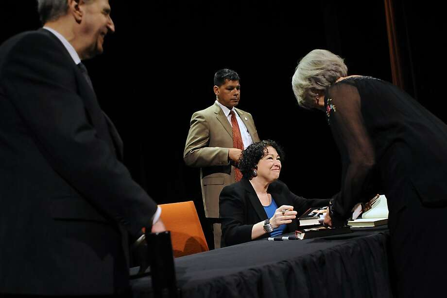 Supreme Court Justice Sonia Sotomayor signs copies of her autobiography at the Commonwealth Club.