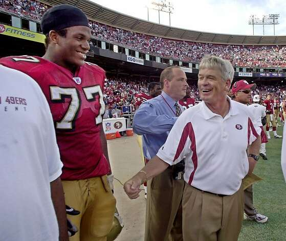 San Francisco 49ers head coach Dennis Erickson, right, smiles at tackle Kwame Harris in the final seconds before the 49ers beat the Tampa Bay Buccaneers 24-7, Sunday, Oct. 19, 2003 in San Francisco. Photo: Paul Sakuma, AP
