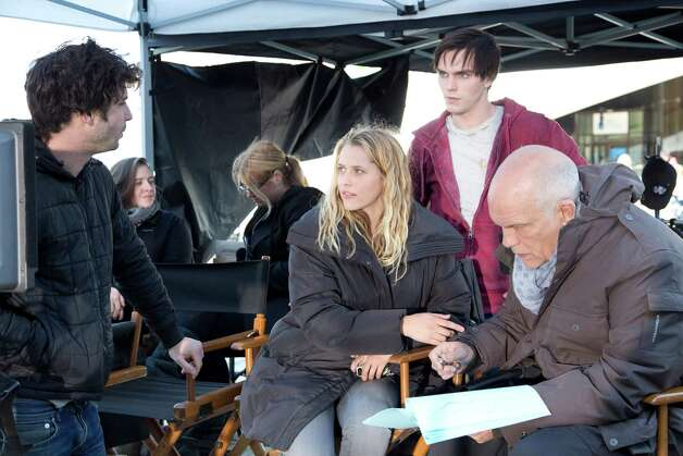 "From left, director Jonthan Levine with stars Teresa Palmer, Nicholas Hoult and John Malkovich on the set of ""Warm Bodies."" (Courtesy of Jan Thijs/Summit Entertainment/MCT) Photo: Jan Thijs, McClatchy-Tribune News Service / Summit Entertainment"