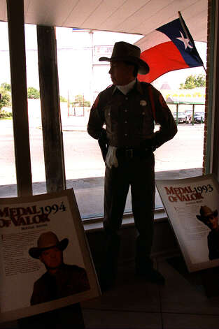 Texas DPS Trooper Bob Bratten stands inside the Grand Opening of the Texas Highway Patrol Museum Saturday morning. Photo: DELCIA LOPEZ, SAN ANTONIO EXPRESS-NEWS / SAN ANTONIO EXPRESS-NEWS