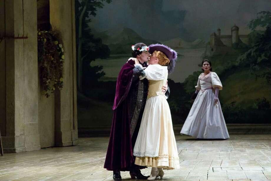 "Don Giovanni (Adrian Erod) romances Zerlina (Malin Christensson) in Houston Grand Opera's ""Don Giovanni."" Photo: Felix Sanchez"