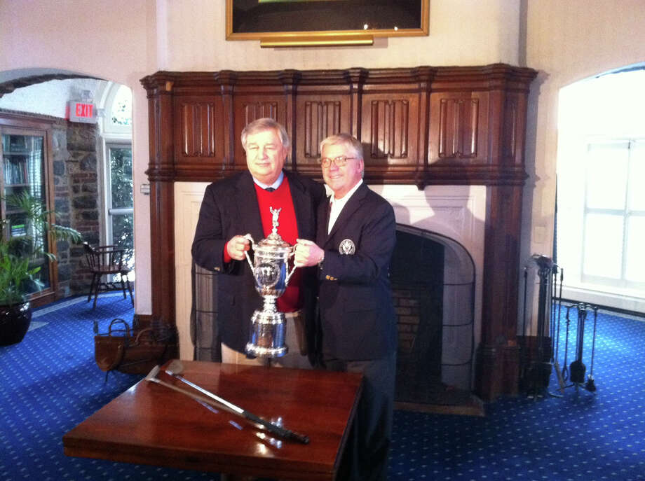 John Schneider, left, a Greenwich resident and current president of Winged Foot Golf Club in Mamaroneck, N.Y., poses with the U.S. Open Championship Trophy with USGA vice president Thomas J. O'Toole Jr., Monday, Jan. 28, 2013, at Winged Foot. The USGA announced Monday that the 2020 U.S. Open Championship will be held at Winged Foot. Photo: Greenwich Time