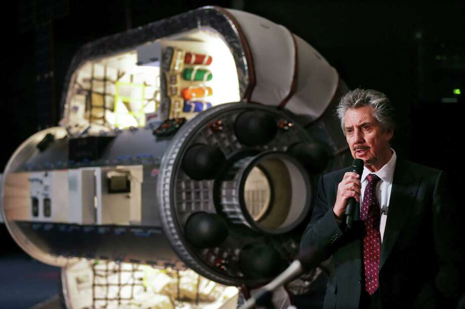 Bigelow Aerospace founder and president Robert Bigelow answers questions from members of the media on Jan. 16. Pictured with Bigelow is a one third scale model of a BA 330 module, similar in function to the what the new Bigelow Expandable Activity Module will be. Photo: Multiple