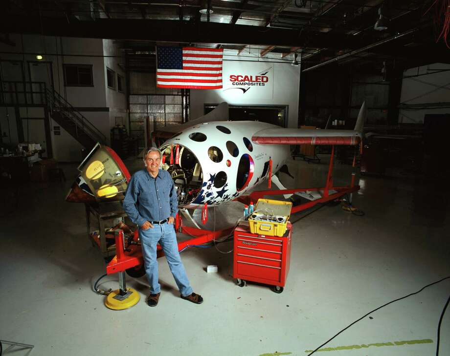 In his workshop, Burt Rutan stands before the spaceship he designed. Burt Rutan designed both SpaceShipOne and the launch vehicle, White Knight. This spaceship is made of epoxy and graphite. It won the ten-million-dollar Ansari X prize. (Getty images) Photo: James A. Sugar, Multiple / National Geographic