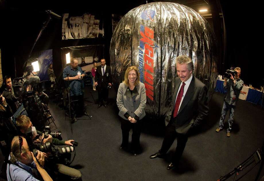 NASA deputy administrator, Lori Garver, left, and Bigelow Aerospace president Robert Bigelow, pose for photos and video in front of the Bigelow Expandable Activity Module during a news conference  Jan. 16 in Las Vegas.  Photo: Multiple