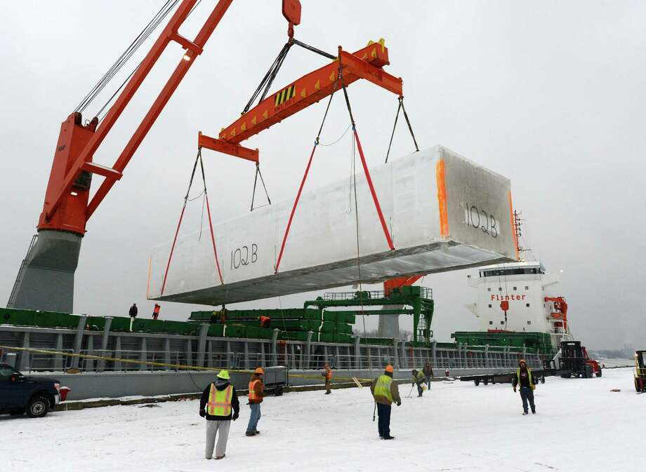 A housing unit built in Sangersfield, N.Y. and bound for Newfoundland is hoisted in to the Flinterstream ship Jan. 28, 2013 in the Port of Albany, N.Y.  (Skip Dickstein/Times Union) Photo: SKIP DICKSTEIN / 00020926A
