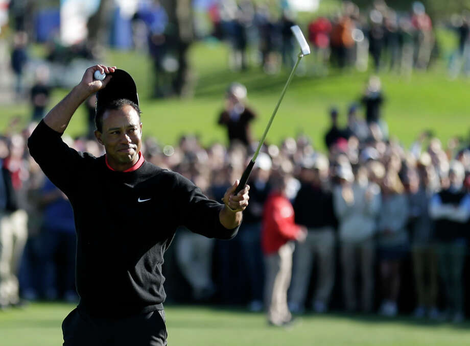Tiger Woods celebrates after his victory in the Farmers Insurance Open golf tournament Monday, Jan. 28, 2013, at Torrey Pines Golf course in San Diego. (AP Photo/Gregory Bull) Photo: Gregory Bull, Associated Press / AP