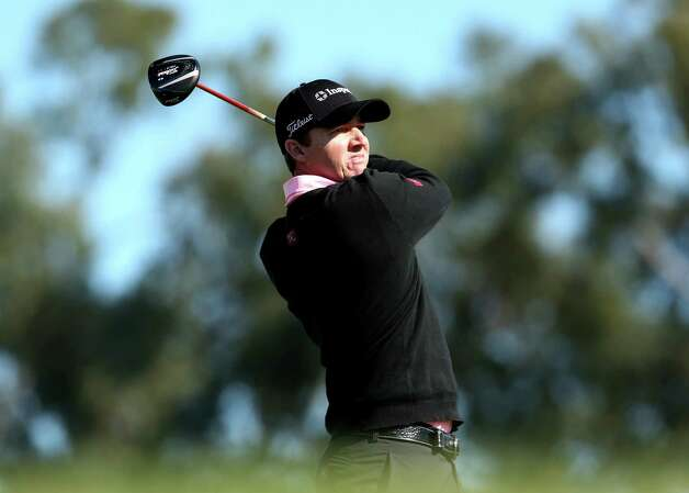 Jimmy Walker hits his tee shot on the ninth hole during the final round of the Farmers Insurance Open on the South Course at Torrey Pines Golf Course on January 28, 2013 in La Jolla, Calif.  Stephen Dunn/Getty Images Photo: Stephen Dunn, Getty Images / 2013 Getty Images
