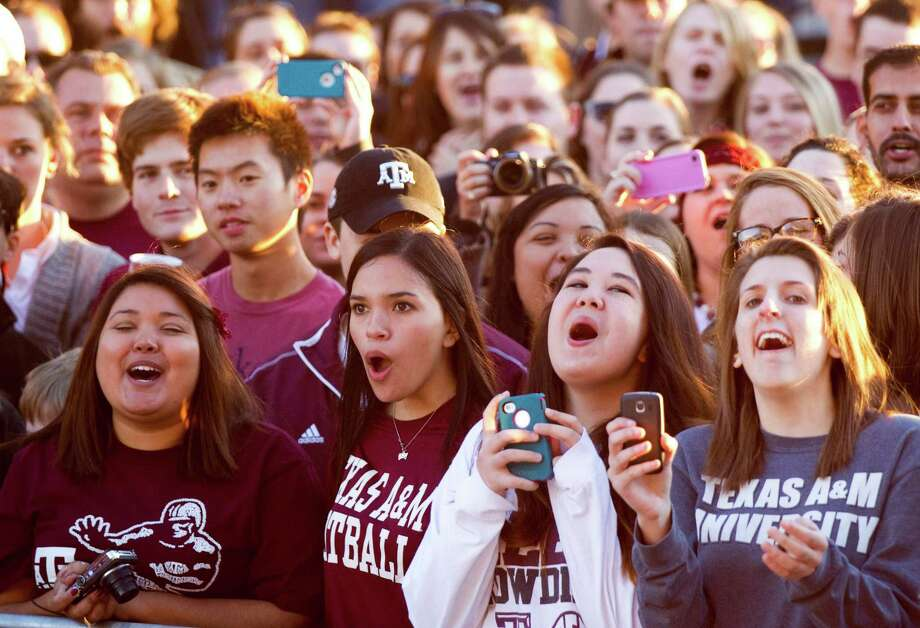 Texas A&M students and fans cheer during a ceremony honoring Heisman Trophy winner Johnny Manziel and three other Aggie football players Wednesday, Dec. 12, 2012, in College Station. ( Brett Coomer / Houston Chronicle ) Photo: Brett Coomer, Houston Chronicle / © 2012 Houston Chronicle