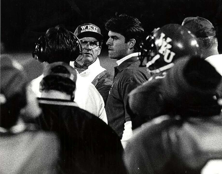 Jack Harbaugh confers with his son, Jim, during a Western Kentucky University Football game against the University of Alabama at Birmingham on Sept. 23, 1995. Photo: Western Kentucky Athletics