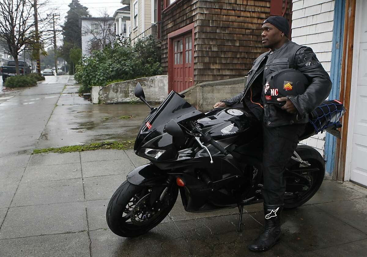 Mike Bailey gets ready for a motorcycle ride in Oakland, Calif. on Wednesday, Jan. 23, 2013. Bailey was diagnosed with stage 4 bladder cancer a few years ago, which he believes was a result of exposure to water contamination at Camp Lejeune, where he was stationed as a Marine.