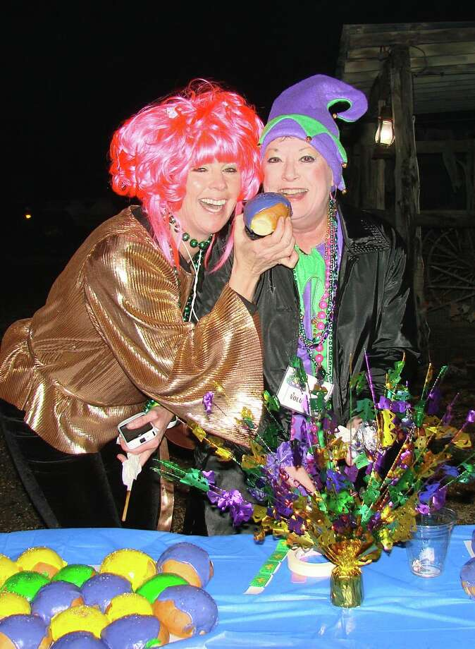 A gumbo cookoff, colorful costumes, king's cake and lots of beads are the tipoff that it's time for Wimberley's Mardi Gras this Saturday. The street party benefits a local charity, My Neighbor's Keeper. Photo: San Antonio Express-News