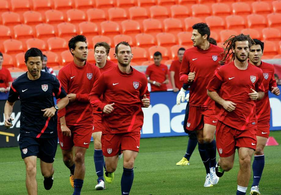Players on the U.S. men's national soccer team warm up at an open practice at BBVA Compass Stadium. Photo: Johnny Hanson, Houston Chronicle / © 2013  Houston Chronicle