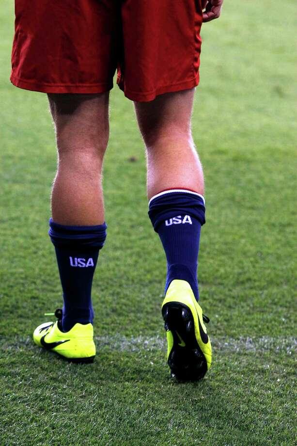 Brad Davis of the Dynamo wears the logo of his new team on his socks. Photo: Johnny Hanson, Houston Chronicle / © 2013  Houston Chronicle