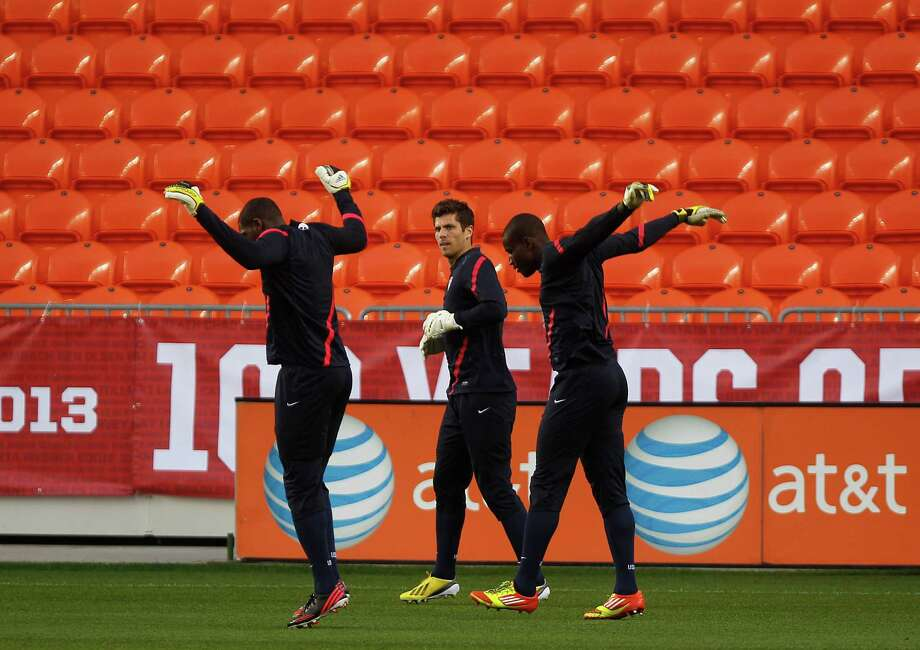 Tally Hall, the Houston Dynamo goal keeper, center, warms up with his national team teammates Bill Hamid and Sean Johnson as the U.S. Men's National Soccer Team held a public training session at BBVA Compass Stadium a day before they play against Canada Monday, Jan. 28, 2013, in Houston. Photo: Johnny Hanson, Houston Chronicle / © 2013  Houston Chronicle