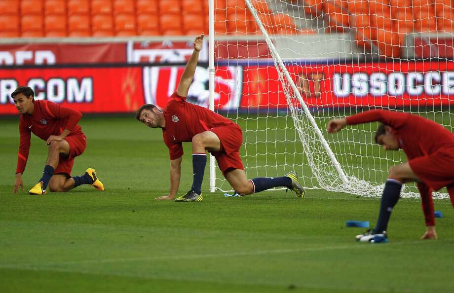 The Houston Dynamo's Will Bruin, center, warms up with as the U.S. Men's National Soccer Team held a public training session at BBVA Compass Stadium a day before they play against Canada Monday, Jan. 28, 2013, in Houston. Photo: Johnny Hanson, Houston Chronicle / © 2013  Houston Chronicle