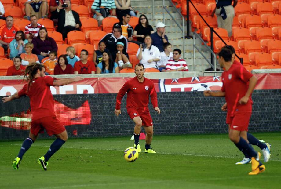 The Houston Dynamo's Brad Davis, center, practices with his national team teammates as the U.S. Men's National Soccer Team held a public training session at BBVA Compass Stadium a day before they play against Canada Monday, Jan. 28, 2013, in Houston. Photo: Johnny Hanson, Houston Chronicle / © 2013  Houston Chronicle