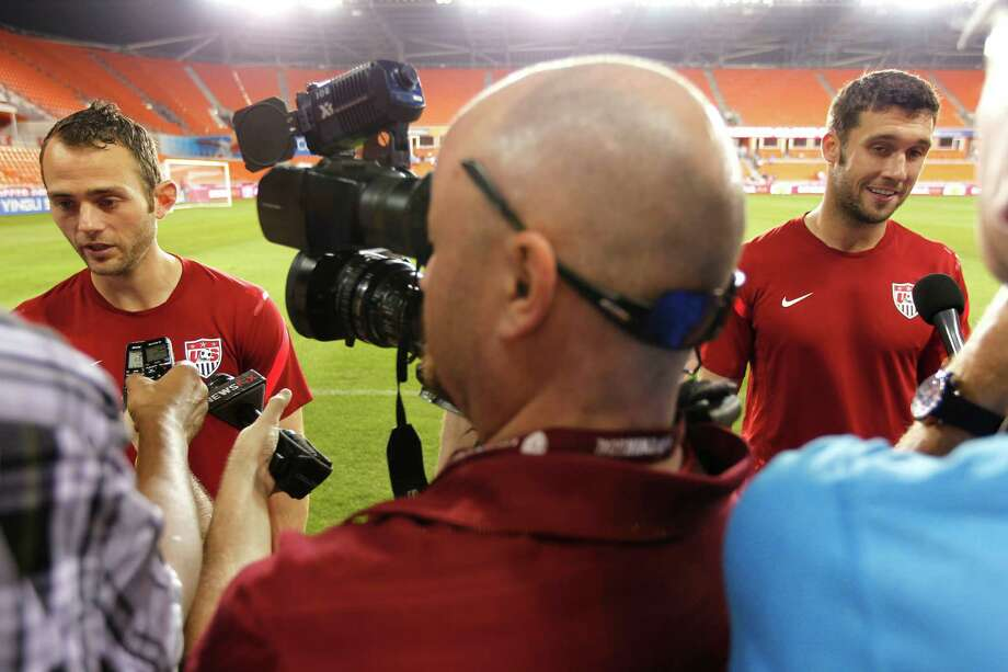 Houston Dynamo teammates and now U.S. National Team teammates, Brad Davis, left, and Will Bruin are interviewed by the media after the U.S. Men's National Soccer Team held a public training session at BBVA Compass Stadium a day before they play against Canada Monday, Jan. 28, 2013, in Houston. Photo: Johnny Hanson, Houston Chronicle / © 2013  Houston Chronicle