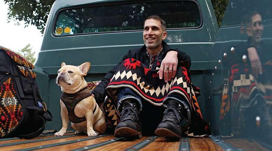 Local designer Benny Gold, with pooch Levi. Photo: Jansport