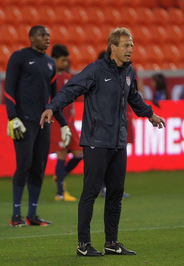 National team coach Jurgen Klinsmann, watches his players scrimmage during an open practice. Photo: Johnny Hanson, Houston Chronicle / © 2013  Houston Chronicle